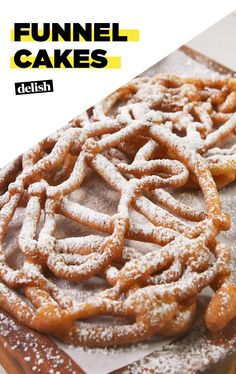 Making Funnel Cake at home is WAY easier than we thought Get the recipe at Delish.com. #recipe #easy #easyrecipe #cake #carnival #dough #dessert #dessertrecipe