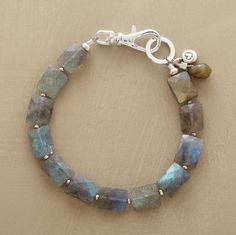 """Harlequin faceting highlights labradorite's inborn iridescence. Sterling silver lobster clasp with dangling accents. Exclusive. Handmade in USA. Approx. 7-1/4""""L."""