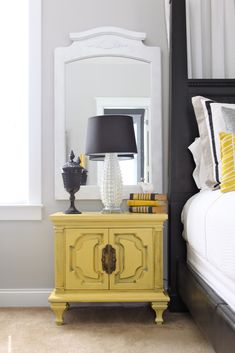 Like the colors. The white lamp with gray shade and mustard night stand.