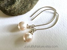 PowerPearls™ handmade by JoyfulByNature. Swarovski pearls. https://www.etsy.com/listing/263239771/modern-earrings-white-pearl-earrings?ga_search_query=Earrings&ref=shop_items_search_16&utm_content=buffer94dc5&utm_medium=social&utm_source=pinterest.com&utm_campaign=buffer #etsymntt #pearls #earrings