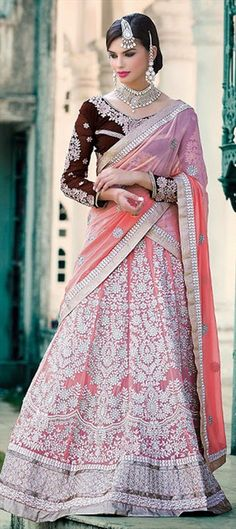 INDIAN WEDDING COUTURE - Keep the event's tone low yet elegant with this bridal #lehenga in pink.  #IndianWedding #Pastel #babypink #Lace #FloralEmbroidery #IndianFashion #wedding #bride #bridalwear #onlineshopping
