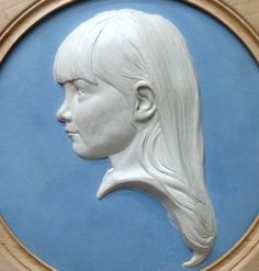 Coloured earthenware in a turned frame #sculpture by #sculptor Tristan MacDougall titled: 'Bas-relief Portrait of a Child (Bust Head Face Relief Child Portrait)'. #TristanMacDougall