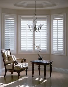 Internal Timber Plantation Style Shutters Western Red Cedar for Bay Window. Painted White with timber rod to open louvres