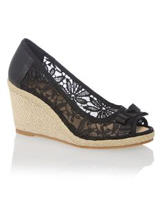 aca60998aff Update your summer shoe collection with these crochet wedge sandals.  Designed with a pretty bow