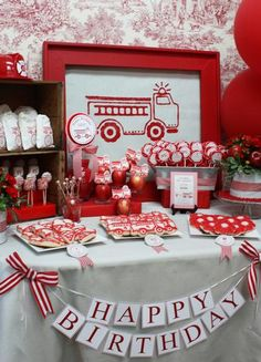 I think my favourite thing (aside from the wonderful theme itself) about this little girls firetruck themed party is the elegant toile backdrop