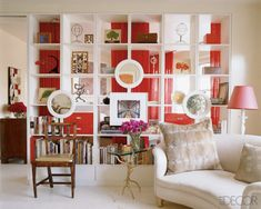 divider- hang mirrors on bookshelf to make space look larger.