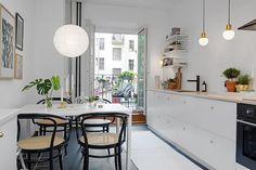 Long white kitchen.