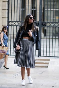justthedesign:  In a fresh new take on a classic look Federica L.has paired this leather jacket with a metallic pleated skirt and a pair of white sneakers. Throw in a pair of shades and a cross body bag to capture every edgy vibe Federica has achieved.  Skirt: Sheinside Jacket: Mango.