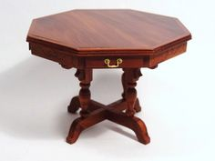 "A LE rosewood octagonal table with four drawers and carved decoration on the apron by Ralph Wakefield. 2.5"" H, 3.5"" W. An usual form, skillfully executed."