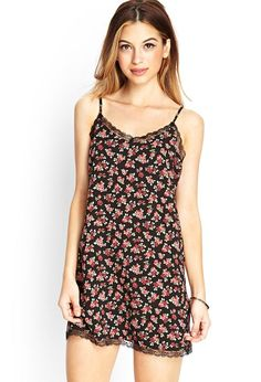 Show off your romantic side in this rose print slip dress, which features a lace trim and adjusta...