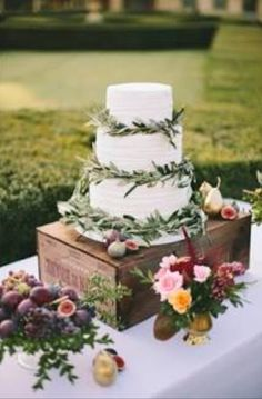 What I want for wedding cake. White traditional wedding cake, olive garnish accent and display.