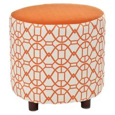 Upholstered ottoman with a lattice motif and exposed legs.      Product: Ottoman    Construction Material: Cotton...