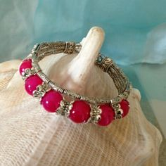 "Tibetan Silver & Pink Beads Bangle $10  To place an order, visit our Facebook page ""Moonsong Jewellery"" or email moonsongjewellery@gmail.com"