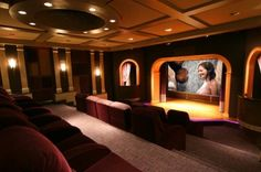 Clever- home theater with a stage! I could just see it being used for so much more than watching movies!