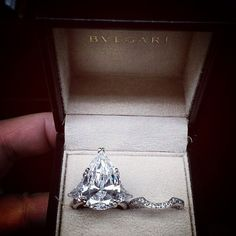 Pear shaped diamond engagement ring with diamond band by BVLGARI