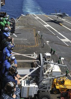 PACIFIC OCEAN (July 16, 2014) Sailors watch as an F/A-18F Super Hornet, assigned to the Flying Eagles of Strike Fighter Squadron (VFA) 122, lands on the flight deck of the aircraft carrier USS Nimitz (CVN 68). Nimitz is currently underway conducting carrier qualifications. (U.S. Navy photo by Mass Communication Specialist 3rd Class Siobhana R. McEwen/Released)