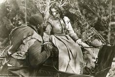 Big Sam comes to help Scarlett after she is attacked in the woods near Shantytown in Gone With The Wind.