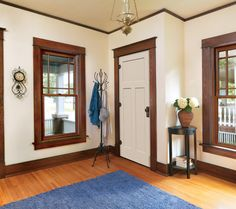 paint colors to complement the wood trim and panelling:   Light cream colours: Benjamin Moore Navajo White or Timid White ; Off-white colours: Benjamin Moore Simply White or Sherwin Williams Westhighland White