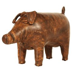 Hand Stitched Leather Piggy Ottoman  England  1950's  A delightful ottoman or doorstop in hand stitched aged leather in the form of a small pig. By Dimitri Omersa. English, circa 1950.