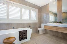 Stunning contemporary modern bathroom vanity in polytec Natural Oak Ravine. Buildcraft 'Aurora' home, bathroom design by James Treble.