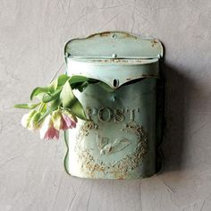 Use this mint-green postbox as a sorting place near your entryway to keep out-the-door items easily accessible. Click for more shabby chic decorating ideas.
