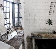 doors, white brick and old wood mantle.