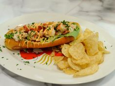 Geoffrey Zakarian's Lobster Roll - This recipe comes together in mere minutes and features plenty of succulent lobster overflowing from buttery grilled buns. http://www.foodnetwork.com/recipes/geoffrey-zakarian/lobster-roll