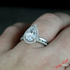 Gorgeous Set including FB Forever Brilliant Moissanite & Diamond pear cut halo with plain band ring. & Half Eternity Diamond Band. Looking for