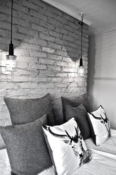 bedroom brick wall + hanging lights