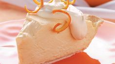 Orange Cheesecake Pie~ Yogurt, lower-fat cream cheese and orange juice concentrate make this creamy dessert  light and refreshing.