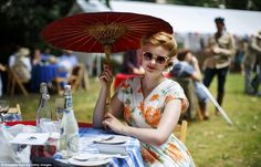 A stylish woman enjoys food and drink at The Chap Olympiad. The event is aimed at revisiting the fashions and pastimes of the polite aspects of to England Tweed Run, Dress Up Boxes, Dressing, Costumes, Stylish, My Style, Pretty, Summer, England