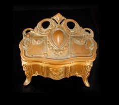 """This Antique victorian very fancy coffin casket box has such rich detail and design. It measures 4"""" long x 2"""" wide x 3 1/2"""" tall . This is HEAVY with gorgeous raised relief on all sides. In great vintage condition. Ask about our ten percent off special, it could save you a lot of money. VintageSparkles offers Layaway on all our pieces regardless of which site it comes from.All layaway payments will need to be in the form of a check or money order only. Please remember that vintage & antique…"""