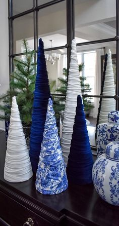 Add some elegance to your holiday display with a gorgeous velvet cone tree. Tall Wide at base Navy stretch velvet material Cone Trees, Cone Christmas Trees, Christmas Tree Crafts, Gold Christmas, Christmas Home, Vintage Christmas, Christmas Ornaments, Christmas Mantles, Christmas Villages