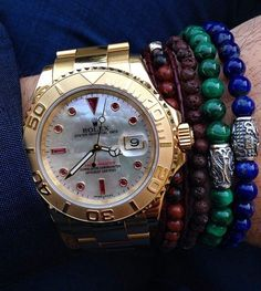 It doesn't get any more iconic than Rolex. Different color beaded bracelets spice up this classic gold Rolex. Muy caliente!