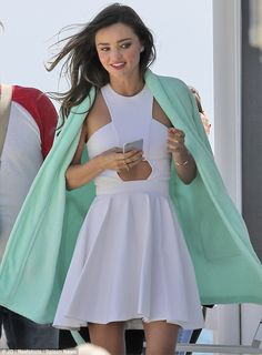 Showing some skin: Miranda Kerr revealed her flat stomach during a photo shoot on Malibu P...