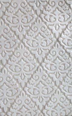 This elegant white backsplash would look pretty in a farmhouse kitchen. Shown here is our Damask handmade tile pattern in a classic Glossy White glaze | juleptile.com