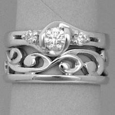 Fitted white gold carved koru wedding band