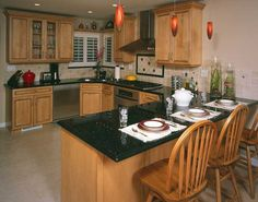 A Simple U Shaped Kitchen Gets Pizzazz From Gold Flecked Black Countertops Red