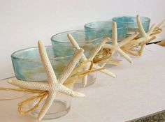 Blue and clear rustic votives with white starfish. Set of 4. via Etsy