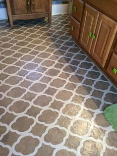 Amazing transformation suzann 39 s bungalow kitchen remodel for Painting vinyl floors with chalk paint