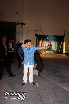 Bradley Steven Perry from GOOD  LUCK CHARLIE trying his hand at archery