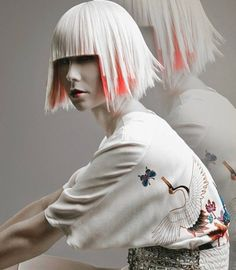 Red graphic peeking hair layer & white top concealing hair colour