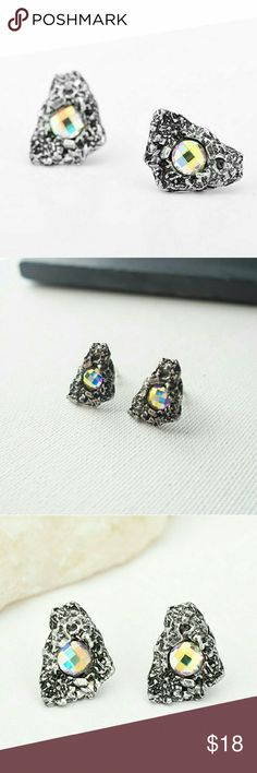 Meteorite Studs Meteorite Studs in Burnish Silver  .66in Long  .5in Wide  Rainbow Crystal center  Hypoallergenic Burnish Silver , Lead/Nickel/Cadmium Free Also Available in Patina and in other shapes in my closet!  NWOT Boutique  Packaged with Care Jewelry Earrings