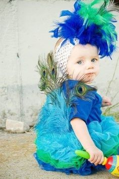We can't get over the ridiculous cuteness of this idea! #halloweencostume #babycostume #peacock