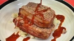 """Bacon-wrapped meatloaf hint: """"Leave the bacon out of the recipe if you like.""""    No, I won't do that. I'm not an idiot.    http://watertown.ynn.com/content/cooking_at_home/570126/recipe---bacon-wrapped-meatloaf/"""