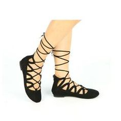 Tie the knot in these strappy lace up flats. Endless crisscross laces and tie closure make these round toe flats extra sweet. #flats #crisscross #roundtoe #laceups #ballerinaflats #newarrivals #black #blackflats