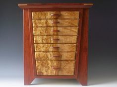 Handcrafted boxes and jewelry boxes using exotic hard woods from around the world.
