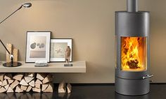images of rooms with modern wood stoves | , Modern stoves, Stoves, Modern stove Living rooms, Living room ...
