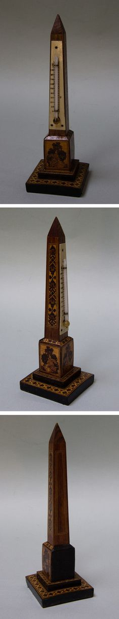 Tunbridge Ware obelisk thermometer. Circa 1900. The thermometer tube is spirit filled and placed on an engraved bone scale. The main obelisk centre is solid rosewood with the tesserae inlaid into the surface of the wood. There are geometric designs around the base with marquetry rural scenes on three sides of the central plinth - Dim: H:  20.00 cm, W: 6.5cm, D: 6.5cm