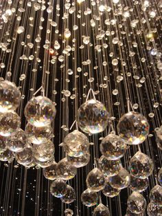 LOVVVVVVVVVVVEEE  these hanging Chrystals.  Add some chandeliers and it is perfect!